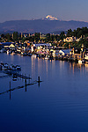 Sunset La Connor with Mount Baker with marinas and downtown along the Swinomish channel Washington State USA.