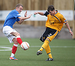 Dean Shiels runs into Jonny Blake