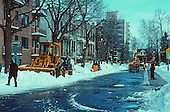 Snow removal crew clearing the street in Montreal after a snowstorm