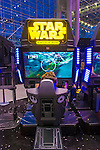 Manhattan, New York City, New York, USA. October 10, 2015. Visitors are playing STAR WARS Battle Pod, an aerial combat game set in the Star Wars universe, at the 10th Annual New York Comic Con. NYCC 2015 is expected to be the biggest one ever, with over 160,000 attending during the 4 day ReedPOP event, from October 8 through Oct 11, at Javits Center in Manhattan