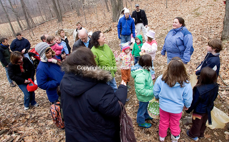 WOODBURY, CT- 16 MARCH 2008- 031608JT09-<br /> Amber Grabowski, right, leads a group of children and parents toward a field scattered with Easter eggs at Flanders Nature Center in Woodbury on Sunday during the Family Fun egg hunt. <br /> Josalee Thrift / Republican-American
