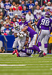 19 October 2014: Buffalo Bills running back Anthony Dixon is tackled after a four-yard gain in the first quarter against the Minnesota Vikings at Ralph Wilson Stadium in Orchard Park, NY. The Bills defeated the Vikings 17-16 in a dramatic, last minute, comeback touchdown drive. Mandatory Credit: Ed Wolfstein Photo *** RAW (NEF) Image File Available ***