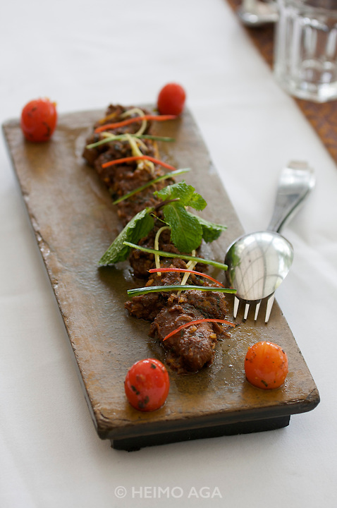 Thonglor (Sukhumvit Soi 55), at this time Bangkok's most fashionable area. Red Contemporary Indian Dining. Adraki Boti: ginger spiced and marinated lamb morsels stir fried with fresh herbs.