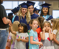 NWA Democrat-Gazette/ANTHONY REYES @NWATONYR<br /> Springdale Har-Ber graduating senior walk Wednesday, May 17, 2017 through the halls of Young Elementary School in Springdale. All the seniors were once students at the elementary school and returned to walk and be congratulated by current students. The seniors were treated to a reunion with former teachers at a reception in the school's media center after the walk.