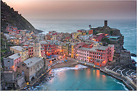 The Cinque Terre village of Vernazza awakens at sunrise. This little fishing town along the coast of Italy is a backpacker's dream, but is quickly becoming more touristy thanks to Rick Steves making it famous. It is hard to take a bad picture in Vernazza. The entire Cinque Terra is beautiful.
