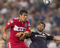 Second half substitute Chicago Fire forward Orr Barouch (15) and New England Revolution defender Franco Coria (2) battle for head ball. In a Major League Soccer (MLS) match, the New England Revolution tied the Chicago Fire, 1-1, at Gillette Stadium on June 18, 2011.