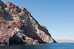 Sea of Cortez, Baja California, Mexico; the rocky shorline along Angel Island in early morning sunlight