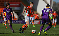 Blackpool's Brad Potts evades Cheltenham Town's James Rowe and Liam Davis<br /> <br /> Photographer Alex Dodd/CameraSport<br /> <br /> The EFL Sky Bet League Two - Blackpool v Cheltenham Town - Saturday 22nd April 2017 - Bloomfield Road - Blackpool<br /> <br /> World Copyright &copy; 2017 CameraSport. All rights reserved. 43 Linden Ave. Countesthorpe. Leicester. England. LE8 5PG - Tel: +44 (0) 116 277 4147 - admin@camerasport.com - www.camerasport.com