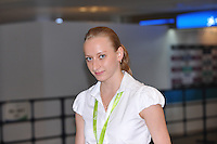 """September 6, 2009; Mie, Japan;  Vera Sessina of Russia poses in """"mixed zone"""" before 2009 World Championships Mie. Vera was the FIG designated gymnast's representative at Mie 2009. Photo by Tom Theobald. .."""