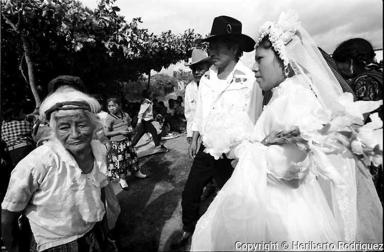 A Zapotec newly-married couple are welcomed by her relatives as they arrive at their house in Coatecas Altas village, Oaxaca, November 22, 1998. Most of the villagers of Coatecas leave their home to harvest in northern state of Sinaloa.  © Photo by Heriberto Rodriguez