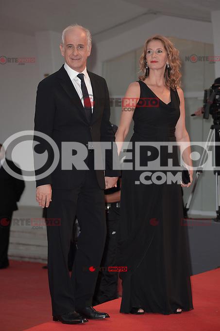 VENICE, ITALY - SEPTEMBER 05: Toni Servillo with his wife? at the 'Bella Addormentata' Premiere during the 69th Venice Film Festival at the Palazzo del Casino on September 5, 2012 in Venice, Italy. &copy;&nbsp;Maria Laura Antonelli/AGF/MediaPunch Inc. ***NO ITALY*** /NortePhoto.com<br /> <br /> **SOLO**VENTA*EN*MEXICO**<br /> **CREDITO*OBLIGATORIO** *No*Venta*A*Terceros*<br /> *No*Sale*So*third* ***No*Se*Permite*Hacer Archivo***No*Sale*So*third*