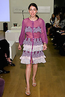 85 Broads member walks runway in a FW10 French lace tiered shirtdress by Yuna Yang, during the 85 Broads Presents Yuna Yang trunk show at Art Gate Gallery on October 24th 2011.