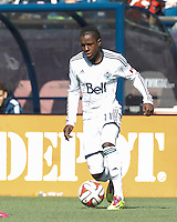 Vancouver Whitecaps FC forward Darren Mattocks (11) on the attack.  In a Major League Soccer (MLS) match, the New England Revolution (blue/white) tied Vancouver Whitecaps FC (white), 0-0, at Gillette Stadium on March 22, 2014.