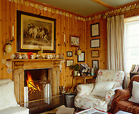The living room is clad with pine panelling decorated with a frieze of scallop shells collected from the beach