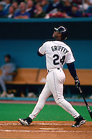 SEATTLE, WA - Ken Griffey Jr. of the Seattle Mariners bats during a game at the Kingdome in Seattle, Washington in 1996. Photo by Brad Mangin