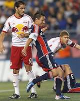 New England Revolution midfielder Diego Fagundez (14) in the mix on a corner kick, scores. In a Major League Soccer (MLS) match, the New England Revolution (blue) tied New York Red Bulls (white), 1-1, at Gillette Stadium on May 11, 2013.