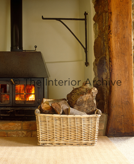 A wood burning stove casts a cheeful glow in a corner of this traditional English cottage