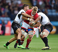 John Moonlight of Canada takes on the Romania defence. Rugby World Cup Pool D match between Canada and Romania on October 6, 2015 at Leicester City Stadium in Leicester, England. Photo by: Patrick Khachfe / Onside Images