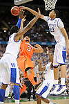 31 MAR 2012: Forward Anthony Davis (23) from the University of Kentucky blocks a shot attempt by guard Peyton Siva (3) from the University of Louisville during the Semifinal Game of the 2012 NCAA Men's Division I Basketball Championship Final Four held at the Mercedes-Benz Superdome hosted by Tulane University in New Orleans, LA. Ryan McKeee/ NCAA Photos.
