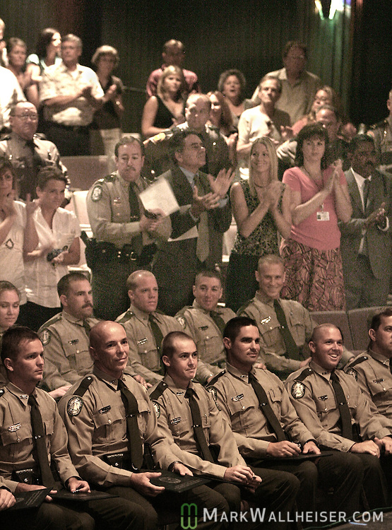 The audience stands and applauds after the graduation ceremonies for 34 new Florida Fish and Wildlife Conservation Commission law enforcement officers in Turner Auditorium at Tallahassee Community College August 16, 2007.  (Mark Wallheiser/TallahasseeStock.com)