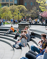 Visitors eat lunch in the drained fountain of Washington Square Park in New York City and enjoy the spring weather on Thursday, May 1, 2014.  Temperatures are expected to rise into the 70's today after more than 24 hours of rain which dumped 4 inches in Central Park.  (© Richard B. Levine)