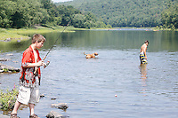 Swimmers and fishermen including Noah Rave, age 11, of Lackawaxen, PA, enjoy the scenic Upper Delaware River on a hot summer day in River Park in Lackawaxen, PA. The Upper Delaware Scenic and Recreational River, part of the National Park Service's Wild and Scenic Rivers System, stretches 73.4 miles along the New York - Pennsylvania border.<br />