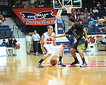 Ole Miss's Marshall Henderson (22) vs. Coastal Carolina's Charles Ashford (10) at the C.M. &quot;Tad&quot; Smith Coliseum in Oxford, Miss. on Tuesday, November 13, 2012. (AP Photo/Oxford Eagle, Bruce Newman)
