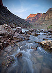 The rising sun illuminates unnamed cliffs along the Colorado River in the Grand Canyon in the Grand Canyon National Park, Arizona, USA