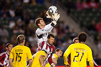 William Hesmer goal keeper for the Columbus Crew leaps high for a ball over Chivas USA forward Alejandro Moreno (15) in the box. Chivas USA and Columbus Crew played to a 0-0 tie at Home Depot Center stadium in Carson, California on  April  9, 2011....
