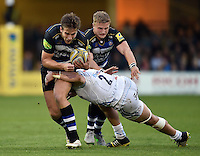 Max Clark of Bath Rugby is tackled by Luke Cowan-Dickie of Exeter Chiefs. West Country Challenge Cup match, between Bath Rugby and Exeter Chiefs on October 10, 2015 at the Recreation Ground in Bath, England. Photo by: Patrick Khachfe / Onside Images