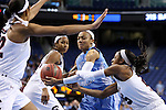27 March 2015: North Carolina's Latifah Coleman (center) is guarded by South Carolina's Tiffany Mitchell (right). The University of North Carolina Tar Heels played the University of South Carolina Gamecocks at the Greensboro Coliseum in Greensboro, North Carolina in a 2014-15 NCAA Division I Women's Basketball Tournament regional semifinal game. South Carolina won the game 67-65.