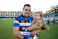 Kahn Fotuali'i of Bath Rugby poses for a photo with one of his sons after the match. Aviva Premiership match, between Bath Rugby and Harlequins on February 18, 2017 at the Recreation Ground in Bath, England. Photo by: Patrick Khachfe / Onside Images