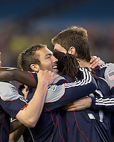 New England Revolution midfielder Shalrie Joseph (21) celebrates his goal with teammates. In a Major League Soccer (MLS) match, the New England Revolution defeated the Vancouver Whitecaps FC, 1-0, at Gillette Stadium on May14, 2011.