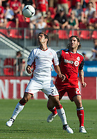 23 June 2011:New England Revolution midfielder Benny Feilhaber #22 and Toronto FC midfielder Torsten Frings #22 in action during an MLS game between the New England Revolution and the Toronto FC at BMO Field in Toronto.