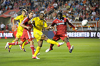 Columbus forward Emilo Renteria (20) shoots over the outstreched leg of Chicago defender Jalil Anibaba (6).  The Chicago Fire defeated the Columbus Crew 2-1 at Toyota Park in Bridgeview, IL on June 23, 2012.