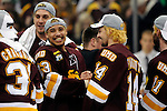 09 APR 2011: Minnesota Duluth players J.T. Brown (23) and Keegan Flaherty (14) congratulate each other after the Bulldogs defeated the University of Michigan to win the Division I Men's Ice Hockey Championship held at the Xcel Energy Center in St. Paul, MN. Minnesota-Duluth beat Michigan in overtime, 3-2 to claim the national title. Vince Muzik/ NCAA Photos