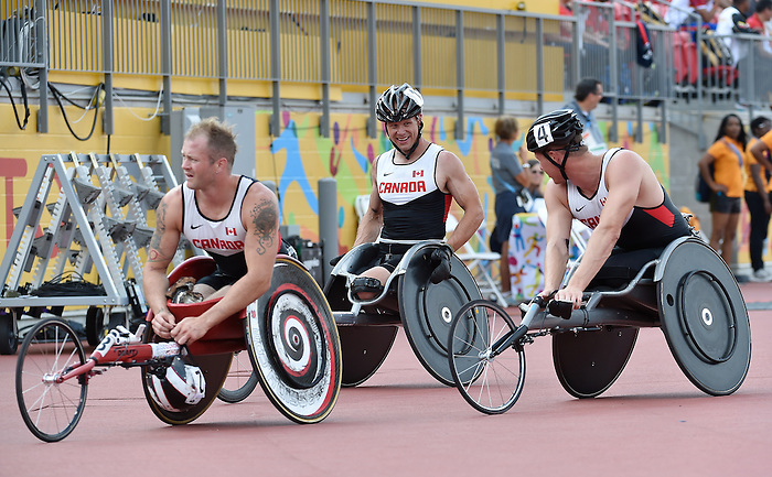 Toronto, ON - Aug 14 2015 - Alex Dupont, Joshua Cassidy and Tristan Smith compete in the Men's 1500m T54 Final in the CIBC Athletics Stadium during the Toronto 2015 Parapan American Games  (Photo: Matthew Murnaghan/Canadian Paralympic Committee)