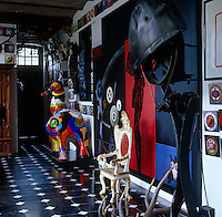 A Niki de Saint Phalle sculpture stands in the entrance hall