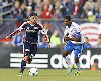 New England Revolution midfielder Lee Nguyen (24) on the attack. In a Major League Soccer (MLS) match, Montreal Impact (white/blue) defeated the New England Revolution (dark blue), 4-2, at Gillette Stadium on September 8, 2013.