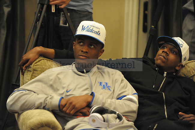 Doron Lamb (left) and Marquis Teague watch during the selection show with the UK basketball team at Coach Calipari's house in Lexington, Ky., on 3/11/12. Photo by Mike Weaver | Staff