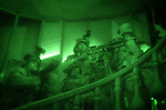 The Marines of Charlie Company 1st BN 4th Marines assault the outskirts of Najaf's Old City in preparation for the final push on the Imam Ali Shrine held by fighters from the Moqtada al-Sadr-led Mehdi Army during the Battle of Najaf on August 25, 2004.<br />