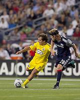 Columbus Crew forward Guillermo Barros Schelotto (7) passes the ball as New England Revolution midfielder Pat Phelan (28) defends. The New England Revolution tied Columbus Crew, 2-2, at Gillette Stadium on September 25, 2010.