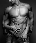 Woman hands touching young muscular man body artistic sensual black and white photo