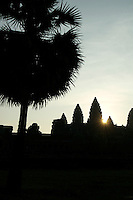 SUNRISE at ANGKOR WAT  the first rays of light breaking at the temple towers.Siam Reap,Cambodia