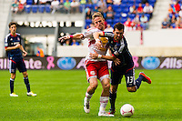 Jan Gunnar Solli (8) of the New York Red Bulls battles for the ball with Gonzalo Segares (13) of the Chicago Fire. The Chicago Fire defeated the New York Red Bulls 2-0 during a Major League Soccer (MLS) match at Red Bull Arena in Harrison, NJ, on October 06, 2012.