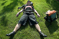 """2 July 2005 - Jersey City, NJ, USA -Tony Berlin, aka """"tonethebone"""", from Newcastle, England, takes a nap after participating in a qualifying race for the 13th annual cycle messenger world championships, Jersey City, USA, July 2nd 2005. More than 700 riders from all over the world took part in the 4-day competition which carries event based on the daily work of a city bike messenger."""