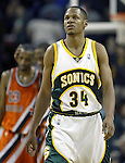 .Seattle SuperSonics Ray Allen looks at the score board as he walks to the Los Angeles Clippers basket after a loose ball foul was called against the Sonics in the fourth period on Friday, April 14, 2006 at the Key Arena in Seattle. Clippers Quinton Ross, left, and Shaun Livingston celebrate their 101-97 win. ... . Jim Bryant Photo. &copy;2010. All Rights Reserved.