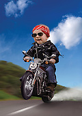 Baby dressed as a biker, popping a wheelie on a motorcycle