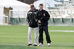 08 December 2005: Maryland head coach Sasho Cirovski (r) walks the field with Wake Forest head coach Jay Vidovich (l) at SAS Stadium in Cary, North Carolina in preparation for the NCAA Men's Division I College Cup semifinals to be played the following day.