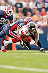 25 September 2005: Michael Jenkins (12), Wide Receiver for the Atlanta Falcons, is tackled by Jabari Greer (33) during a kickoff return in a game against the Buffalo Bills. The Falcons defeated the Bills 24-16 at Ralph Wilson Stadium in Orchard Park, NY.<br /><br />Mandatory Photo Credit: Ed Wolfstein.